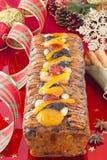Z świąteczną dekoracją bożenarodzeniowy Fruit-cake Obrazy Stock