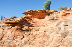 Z-Bend: Cliff Side. Cliff side textural detail in the the Kalbarri National Park Z-bend landscape with red, layered sandstone rock formations with hint of Royalty Free Stock Photo