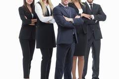 z bliska fachowa biznes drużyny pozycja z rękami krzyżować Odizolowywający na bielu zdjęcia stock