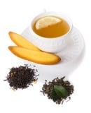 Z ciastkiem herbaciana filiżanka Obraz Royalty Free