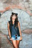 Zła dziewczyna z rzemiennymi kotów ucho Fotografia Stock