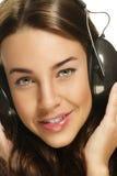 Z hełmofonami piękna kobieta Zdjęcie Royalty Free