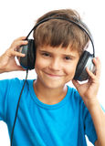 Z hełmofonami uśmiechnięta chłopiec Zdjęcie Royalty Free