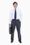 Z jego walizką uśmiechnięty tradesman Obrazy Stock