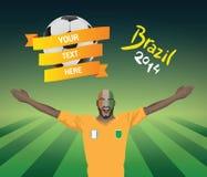 Z kości słoniowej wybrzeża fan piłki nożnej Obraz Royalty Free