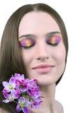 Z kwiatami piękna dziewczyna Obraz Royalty Free