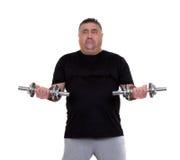 Z nadwagą mężczyzna robi sprawności fizycznych ćwiczeniom Obrazy Royalty Free