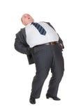 Z nadwagą mężczyzna z bólem pleców fotografia royalty free
