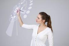 z nowoczesnej technologii Kobieta pracuje z futurystycznym interfejsem Zdjęcie Royalty Free