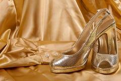Złoci buty Obraz Royalty Free