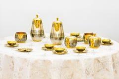 złocista ustalona herbata Zdjęcia Stock