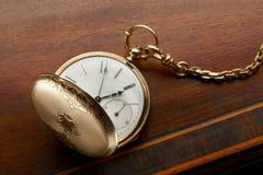 złocisty kieszeniowy zegarek Fotografia Stock