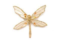 złota dragonfly akcesoryjna forma fotografia royalty free