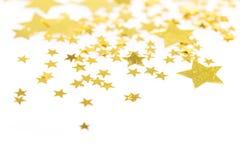 Złote gwiazdy w postaci confetti na tle Zdjęcie Stock