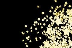 Złote gwiazdy w postaci confetti na tle Fotografia Stock