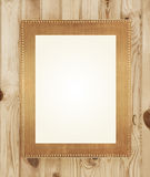 Złoto rama na drewnianym tle Fotografia Stock