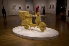 Złoty motocykl grafiki muzeum Obrazy Royalty Free