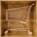 złoty wózka na zakupy Obrazy Royalty Free