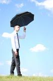 Z parasolem biznesowy mężczyzna Zdjęcie Royalty Free