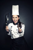 Z podnieceniem żeński szef kuchni lub piekarniany przygotowywający kucharz Fotografia Stock