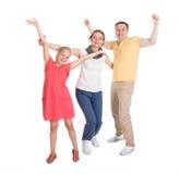 Z podnieceniem młody szczęśliwy rodzinny doskakiwanie Fotografia Stock