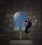 Z podnieceniem studencki doskakiwanie na keyhole Zdjęcia Stock