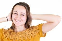 Z podnieceniem szczęśliwy młodej kobiety uczucie radował się odosobnionego przy białym tłem fotografia royalty free