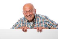 Z pustą deską starszy mężczyzna Zdjęcie Royalty Free