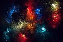 Z różnorodnymi colours bożonarodzeniowe światła tło Obraz Stock