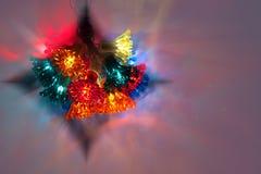 Z różnorodnymi colours bożonarodzeniowe światła tło Fotografia Stock