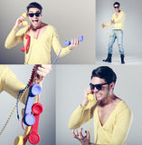 Z retro kolorowymi telefonami centrum telefoniczne śmieszny facet Zdjęcie Royalty Free
