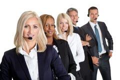 Z słuchawkami biznes pomyślna drużyna Zdjęcia Stock