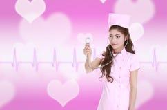 Z stetoskopem żeńska pielęgniarka Zdjęcia Stock