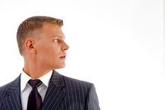 z ukosa przyglądający biznesmena portret zdjęcie stock