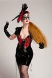 z włosami długa maskowa kobieta Fotografia Stock