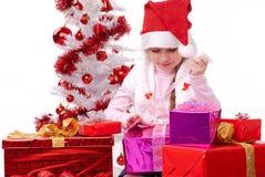 Z wiele szczęśliwa mała dziewczynka Bożenarodzeniowa teraźniejszość Obraz Stock