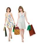 Z zakupami dwa szczęśliwego przyjaciela. Zdjęcie Royalty Free