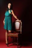 Z zieloną suknią dziewczyna Obrazy Royalty Free