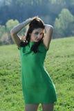 Z zieloną suknią dziewczyna Zdjęcie Stock