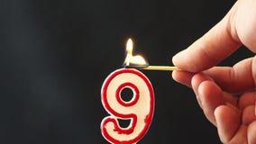 Zaświecać numerowe dziewięć świeczek zdjęcie wideo