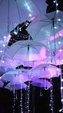 Zaświeca up parasole w zmroku obrazy stock
