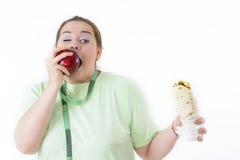 Zażywna kobieta ono Zmaga się Jeść Zdrowego Obraz Stock