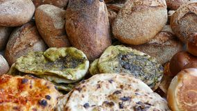 Za`atar Flat-breads and Handcrafted Bread Loaves. Middle-eastern specialty flat bread with hyssop and olive oil, with a variety of other types of flat breads and Royalty Free Stock Image