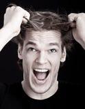 Zaakcentowany mężczyzna ciągnięcia włosy Obrazy Stock