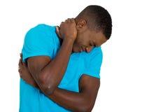 Zaakcentowany, nieszczęśliwy młody przystojny mężczyzna z złym szyja bólem, Zdjęcia Royalty Free