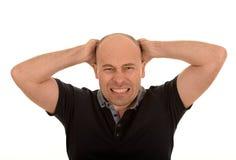 Zaakcentowany łysy mężczyzna Zdjęcie Stock