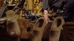 Zaanse Schans. Amsterdam December 2018. Manufacturer of traditional Dutch shoes made of wood- Klomp.  stock video