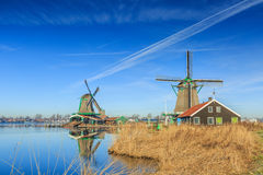Zaanse Schans. General view Zaanse Schans Zaandam in the Netherlands with the historic Mills De Zoeker on the foreground en Het Jonge Schaap on the background stock photography