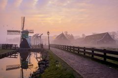 Sunrise in the Zaanse Schans. The Zaanse Schans is a neighborhood with historic wooden buildings in the municipality of Zaanstad. It is located on the Zaan stock photo