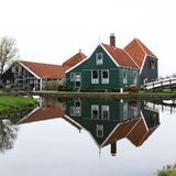 A HOUSE REFLECTING AT THE CALM WATERS OF ZAANSE SCHANS stock photos
